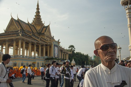 Man Awaits Arrival of the Dear Departed King Father Sihanouk at Royal Palace