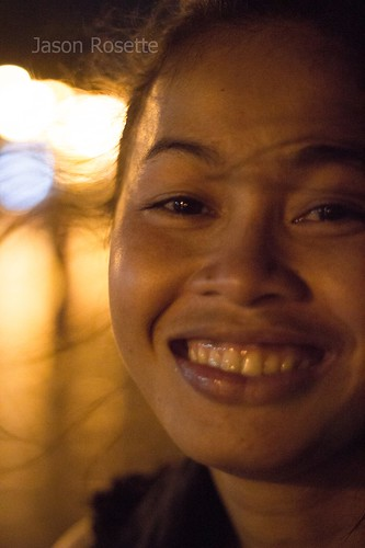 Close up of Cambodian woman smiling at night