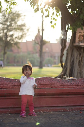 Young girl eats a cookie in Phnom Penh
