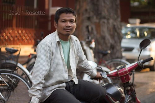 Motorcycle taxi driver atop his moto in Phnom Penh