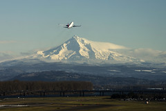 Take off over snowy Mount Hood