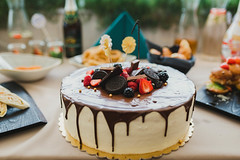 Tasty Homemade White Cake With Chocolate Glaze And Berries On Top