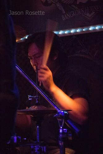 Heavy Metal Drummer in Bangkok, Seen in Profile