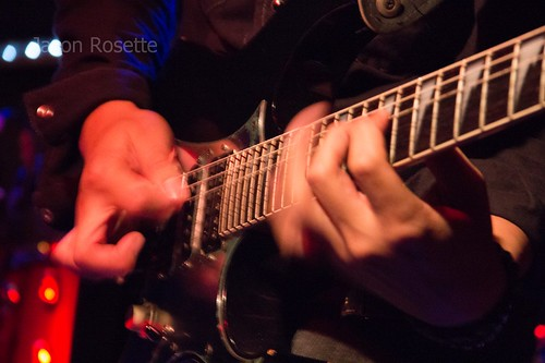 Close up hands of heavy metal guitarist on fretboard