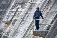 Jay Chamberlin on dam ledge platform close up