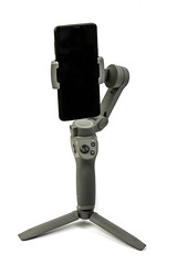 DJI Osmo Mobile 3 phone gimbal with mobile phone attached above white background