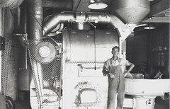 Andy Rae and coffee roasting machine, Bushells Tea Factory, Sydney, 1936