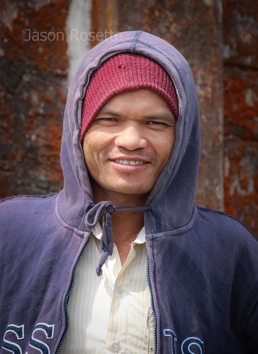 Portrait of Cambodian Worker in Front of Colonial Church on Bokor Mountain