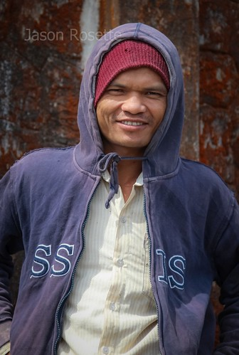 Portrait of Cambodian Worker in Front of Colonial Church on Bokor Mountain (wider)