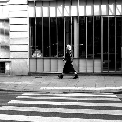 Behind the pedestrian crossing