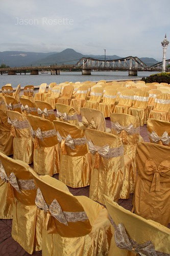Rows of Empty Golden Chairs by the Riverside, Cambodia