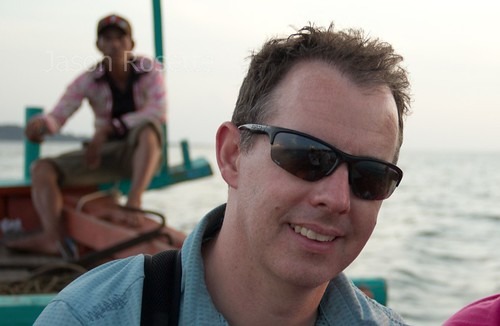 Man with Sunglasses on Small Boat in Tonle Sap Lake, Cambodia