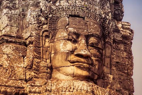 Massive Stone Face of Angkorian King at Bayon Temple, Siem Reap