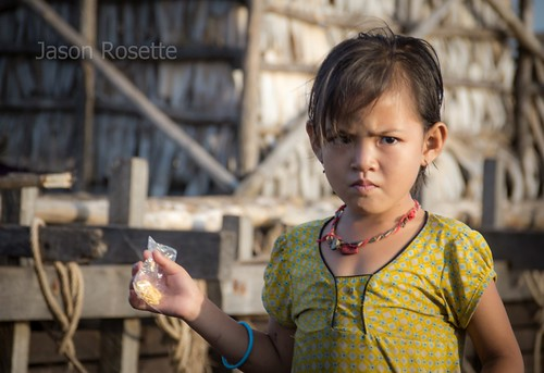 Girl Stands in Front of Her Floating House, Tonle Sap Lake, Siem Reap