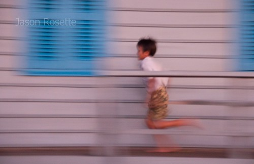 Boy Running Along the Edge of his Floating House, Siem Reap