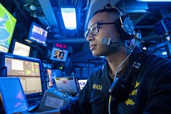 A Sailor stands watch in the command control center aboard USS John P. Murtha (LPD 26) as the ship arrives in Subic Bay, Philippines.