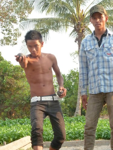 Youths in Cambodia play Petanque in the Countryside