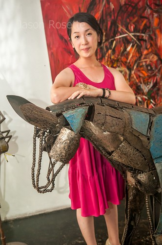 Filmmaker at the 2010 Bangkok Indiefest Poses with Sculpture