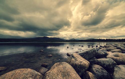 Gloomy atmosphere at moody Loch Morlich, Cairngorms National Park..