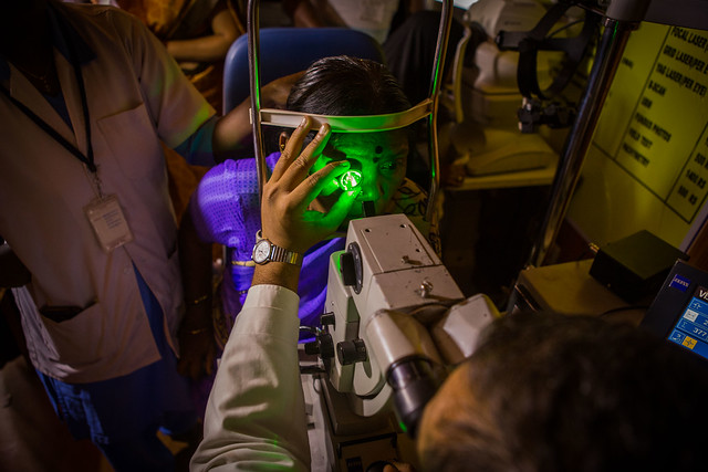 Laser treatment being done inside a mobile eye van for a patient with Diabetic Retinopathy