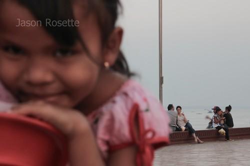 Girl Gazes into the Camera at Riverside in Phnom Penh, Cambodia