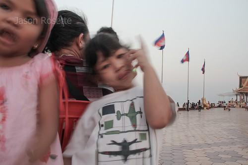 Girls Goofing Around Near Mother, Phnom Penh Riverside