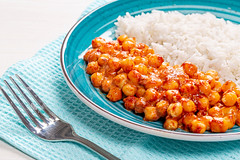 Closeup chickpeas in tomato sauce with rice
