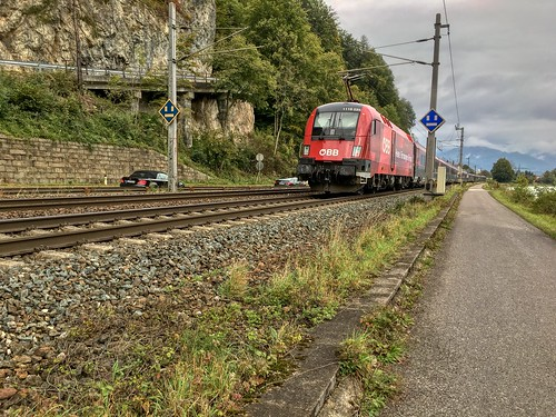 ÖBB railjet express train passing the river Inn between Kufstein, Tyrol, Austria and Kiefersfelden, Bavaria, Germany