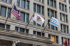 "The flags of the US, of the State of Illinois and of the City of Chicago blowing in the ""Windy city"""