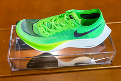 Fast racing shoe Nike ZoomX Vaporfly NEXT% in green on display at the Chicago Marathon 2019 Expo