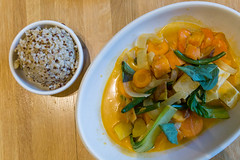 Healthy, seasonal food in Chicago: True Food Kitchen's Spicy Panang Curry. A gluten-free bowl with sweet potato, green bean, bok choy, rainbow carrot, thai basil, coconut curry broth