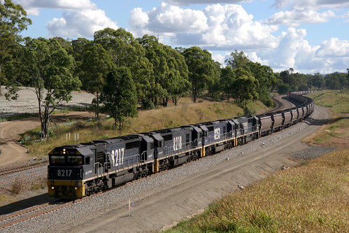 14451 (914) 10-04-2013 Pacific National diesel locomotives 8217 + 8218 + 8253 + 8221 up coal Wambo to Port Kembla nearing railway station Lochinvar, in the Hunter Valley west of Newcastle, N.S.W. Australia.