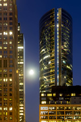 Night image of the Nuveen global headquarters in Downtown Chicago, seen from the side