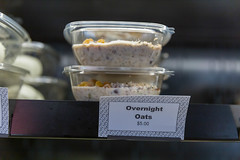 Healthy food to go: overnight oats in a plastic bowl to take away for breakfast
