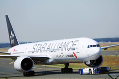 Air China Star Alliance plane being towed in Frankfurt Airport