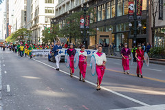 Many different communities and people in traditional costumes join the Columbus Day Parade in Chicago