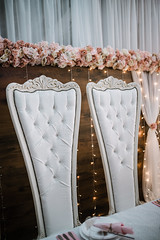 Beautiful wedding vintage chairs with a flowers.