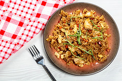Top view of rice with chicken and vegetables