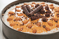 Tasty chocolate cake with almonds and chocolate