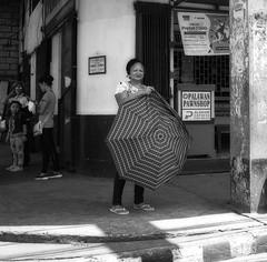 Wrestling with her Umbrella
