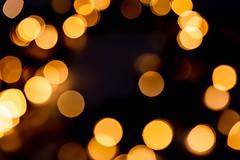 Festive background with blurred garland glow