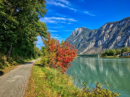 River Inn with Zahmer Kaiser mountains in autumn in Kiefersfelden, Bavaria, Germany
