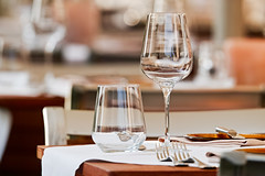 Glasses and cutlery on a table at a luxury restaurant