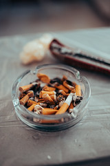 Close-up of an ashtray full of cigarettes butts