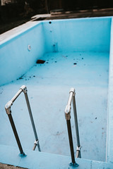Empty blue swimming pool prepare for clean up