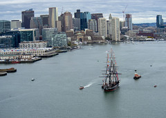 USS Constitution is tugged through Boston Harbor during Constitution's birthday cruise.