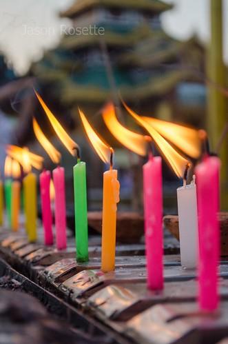 Row of Colorful Candles at Shwedagon Pagoda, Burma