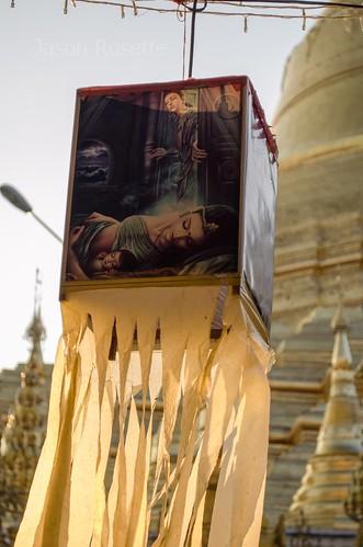 Close up of Lantern with Sleeping Buddha, Shwedagon Pagoda in Background