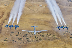 """The U.S. Navy Flight Demonstration Squadron, the Blue Angels, fly in formation with the B-29 Superfortress """"Doc""""."""