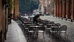 Setting up for the day. Looking along Via Santo Stefano toward Piazza Santo Stefano in Bologna, Italy